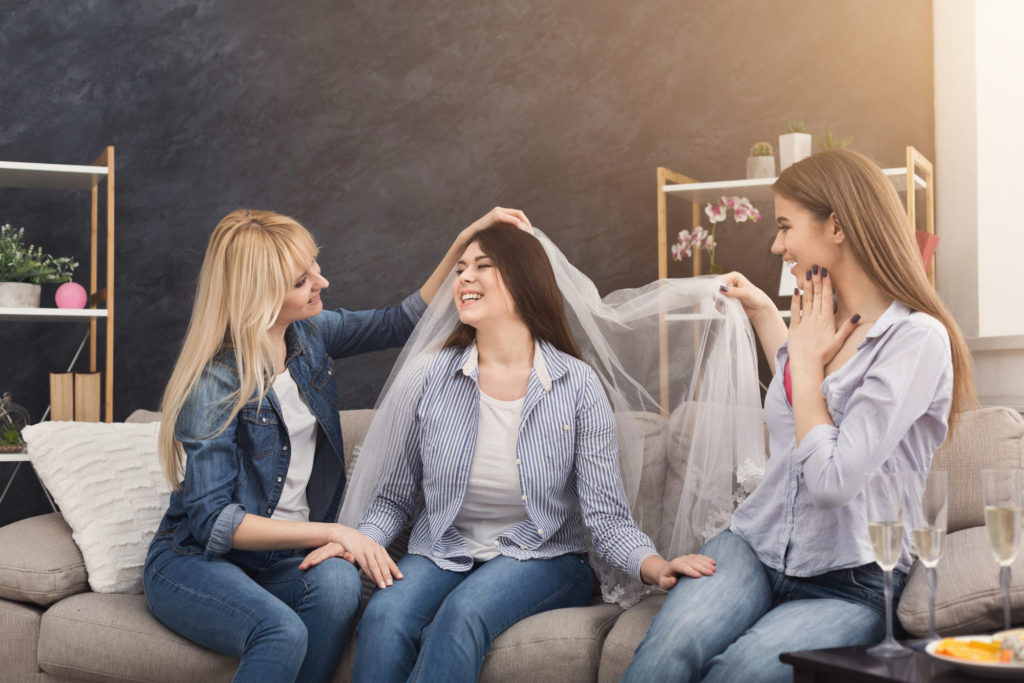 bride preparing for wedding with friends