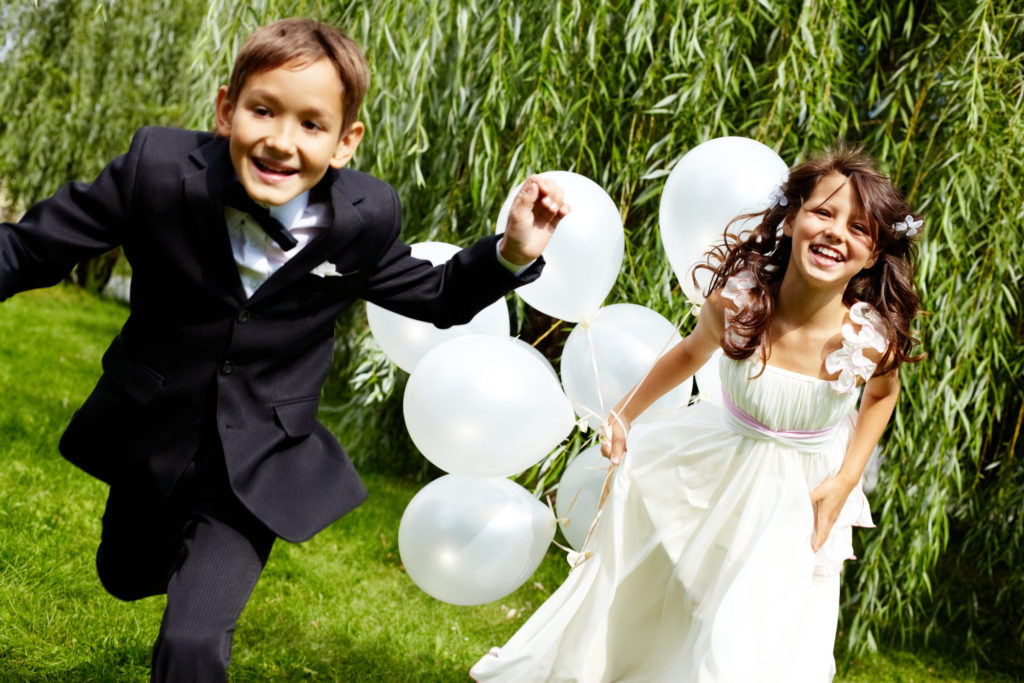kids running at wedding - wedding guest list