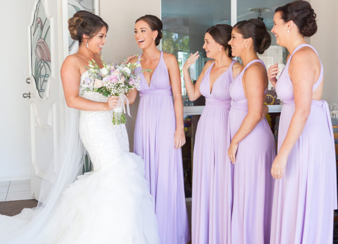 Wedding Planning Pain Points - Bridesmaid Budgeting - Bridesmaids Wearing Lavender Dresses