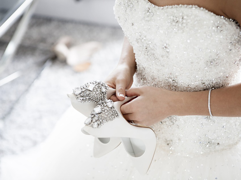Online Wedding Shopping - Bride Holding Jeweled High Heels