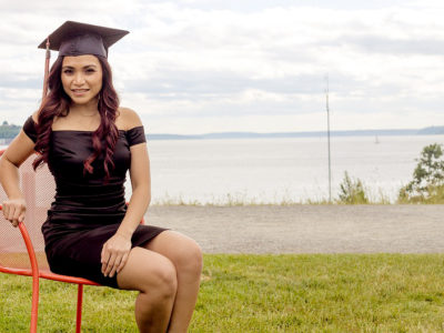 Graduation Party Ideas - Female High School Graduate Sitting On Chair