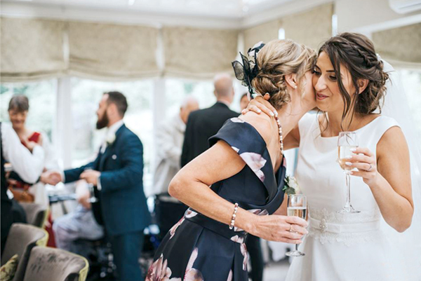 Wedding Guests Care About - Bride Hugging A Wedding Guest