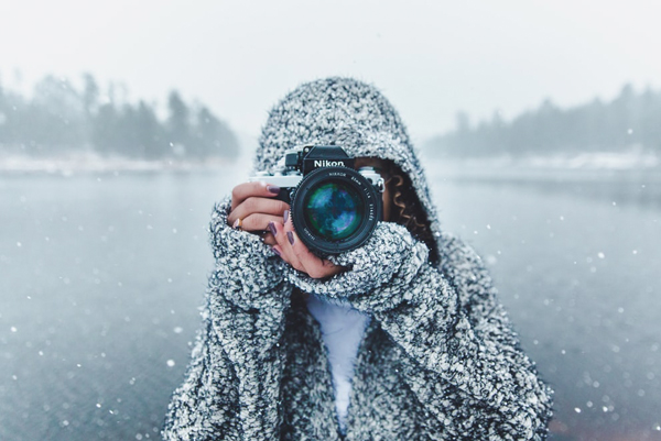 Wedding Guests Care About - Woman In Hooded Sweater In The Snow Taking A Photo With Nikon Camera