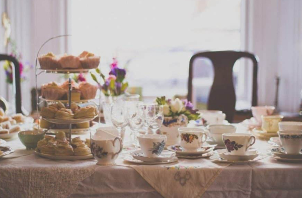 Thrift Store Wedding Decor - Mismatched Teacups On Table With Cupcake Tree